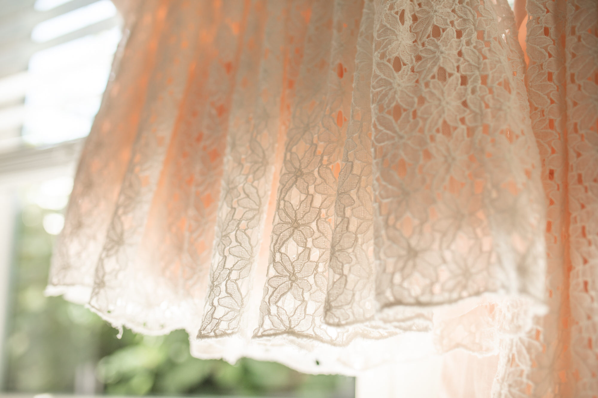 a dress hanging in a window