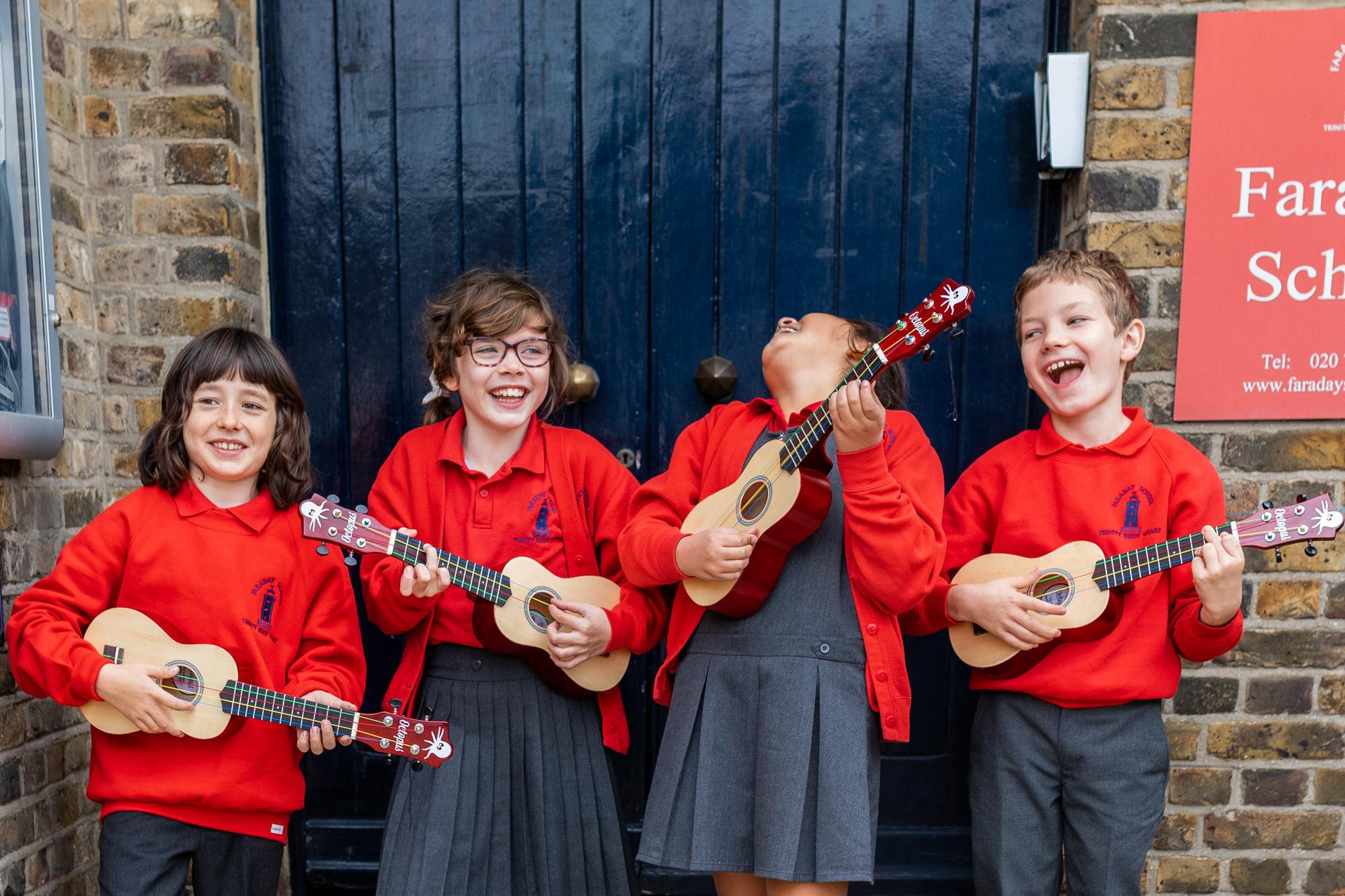 children playing ukeleles, , photographed by Hertfordshire school photographer Alannah Hebbert