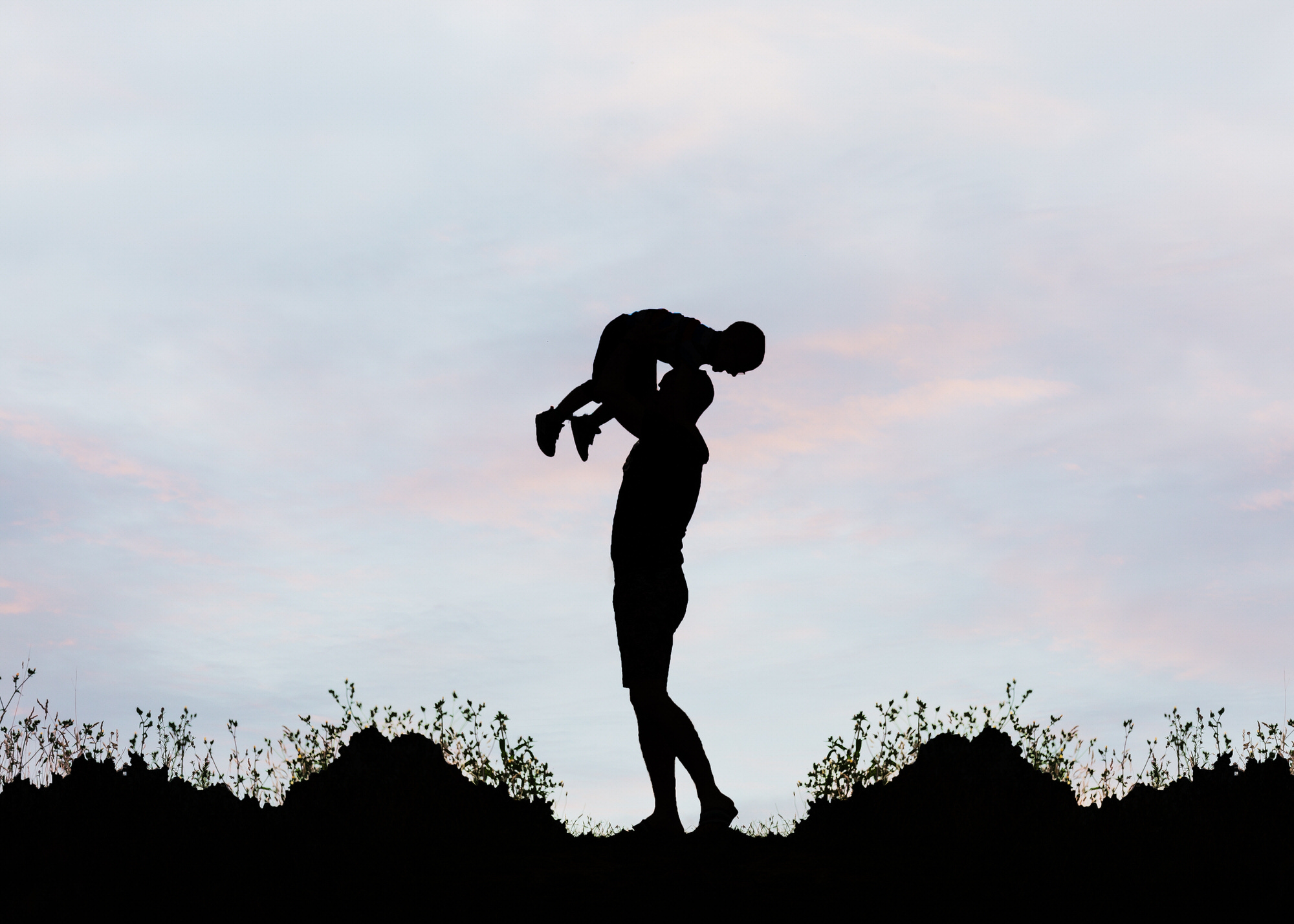 father and son silhouette,, photographed by a Stevenage family photographer