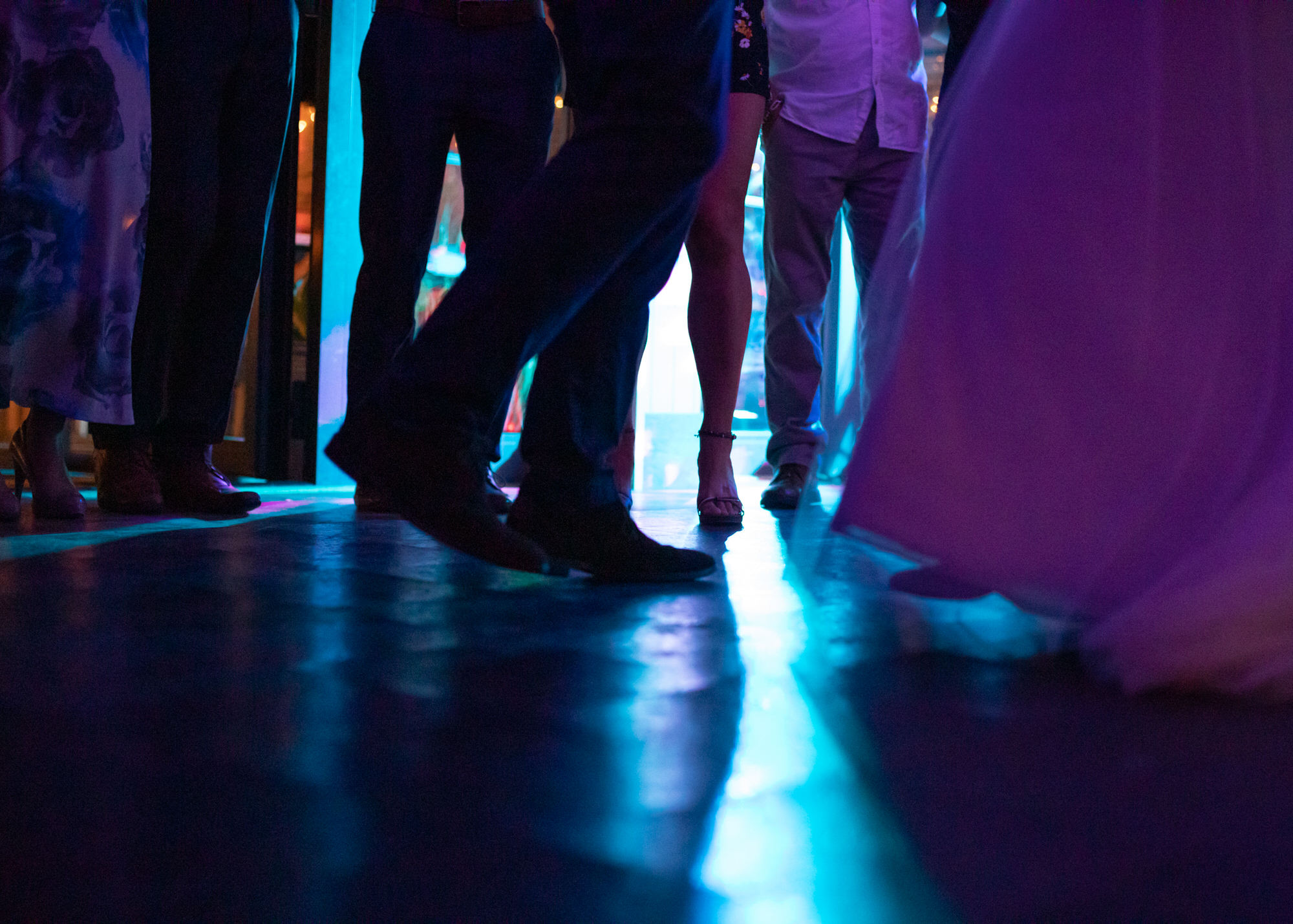 legs and feet of people dancing at a party, photographed by a Stevenage christening photographer