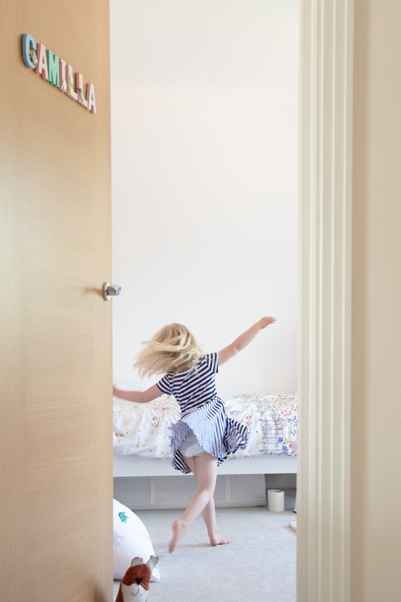 child dancing at family photo shoot at home, photographed by Welwyn family photographer