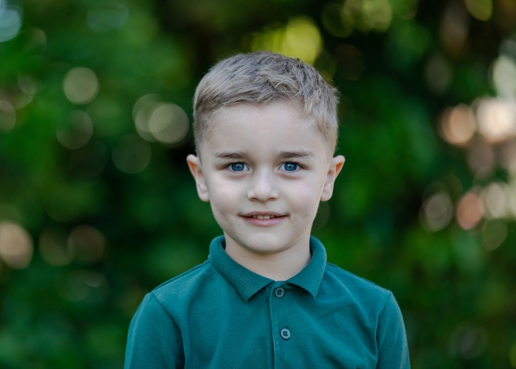 Natural school portrait of a boy taken by school portrait photographer Alannah Hebbert